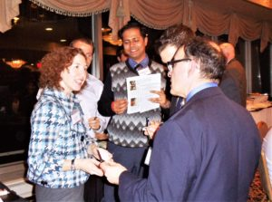 People chatting at a professional networking event