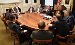 Mayor Peduto talking to a group of men and women around a conference table