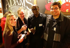 People from different countries enjoying a drink at a First Thursdays event
